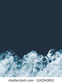 Natural ice texture isolated on a dark background close-up. Abstract background of ice structure. Freezing glacial, front view. Icy shape. Place for text