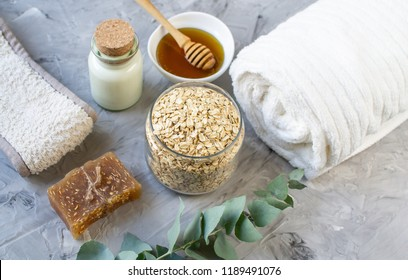 Natural Ingredients Homemade Body Oatmeal Sea Salt Scrub with Olive Oil Honey Milk White Towel Beauty Concept Skin Care Organic Aroma Spa Therapy