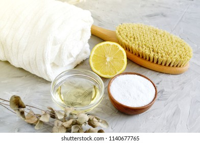 Natural Ingredients for Homemade Body Sea Salt Scrub Lemon Olive Oil White Towel Beauty Concept Skincare Organic Wooden Body Massage Brush Aroma Spa Therapy
