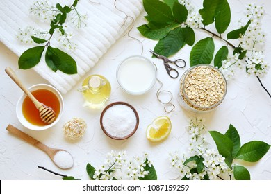 Natural Ingredients for Homemade Oat Body Face Milk Scrub Salt Oil Honey Beauty Concept Organic Eco Healthy Lifestyle Flowers