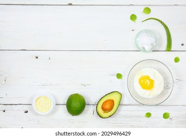 Natural ingredients for smoothing, softening and hydrating your hair.  Avocado, aloe vera,  yogurt, coconut oil, shea butter and  egg yolk for hair mask, flat lay, copy space.