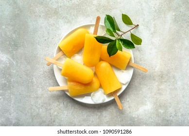 Natural juicy orange popsicles. Refreshing ice pops, overhead, flat lay