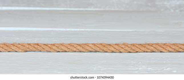 A natural jute rope on light blue background