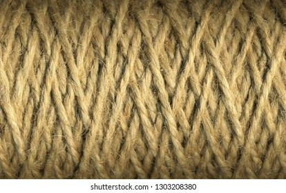 Natural jute twine roll, skein of jute thread texture. micro shot of a coil of jute twine. Supplies and tools for handmade hobby leisure closeup.