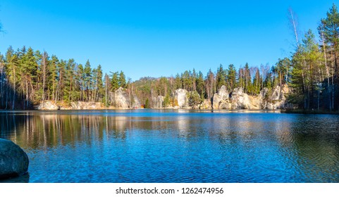 Natural lake in Adrspach rocks on sunny autumn day. Adrspach-Teplice sandstone rock town, Czech Republic.