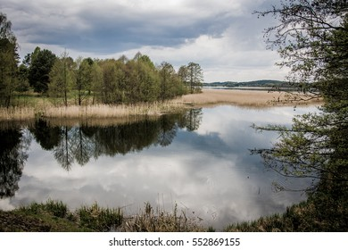 Natural lake landscape with the reflection of the trees and sky in the water