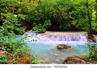 natural landscape of the Alta Val d'Elsa river park in Tuscany Italy known as the Turquoise River. The blue color of the water is due to the thermal springs that feed it