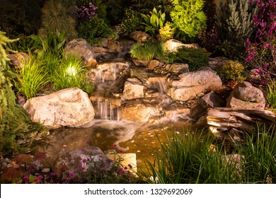Natural landscape design featuring waterfalls, plants and dramatic lighting.