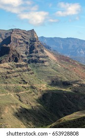 Natural landscape with impressive high mountains and typically vegetation while exploring the island gran canaria, canary islands, spain. Amazing perspective of the environment in this region.