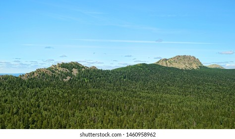 Natural landscape mountain rocks, slopes of Southern Urals. Beautiful view from top of rock mountain in Urals. summer landscape in mountains. trekking to rocky mountain. national Park Taganay, Russia