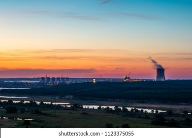 Natural landscape with NPP or Nuclear Power Plant after sunset