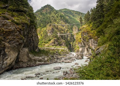 The natural landscape with Tenzing-Hillary Suspension Bridge crossing the river in Sagarmatha national park, Nepal. An iconic memorial bridge during Everest base camp treks.