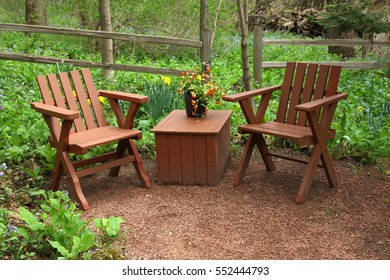 Natural landscaped back yard with outdoor furniture during springtime.