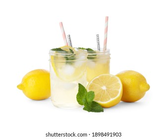 Natural lemonade with mint and fresh fruits on white background. Summer refreshing drink