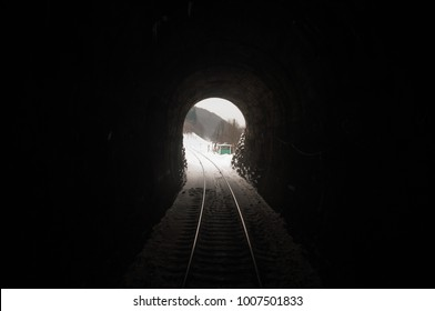 Natural light at the end of the tunnel. Light at the end of railroad tunnel. Space for text.