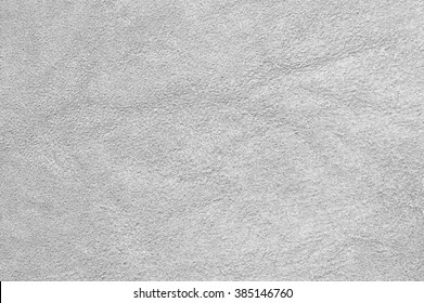Natural light gray suede texture as background.