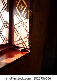 natural light ing and shadows inside buddhism temple building windows frame in a province in northern THAILAND with nice smooth golden pattern in north THAI style