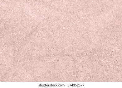 Natural light pink suede texture as background.