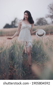 natural light portrait beautiful asian women girl in a while wedding dress and hut for walk relax on the agriculture barley rice fields at chiang mai Thailand, alone nature people concept vintage styl - Shutterstock ID 1905804592