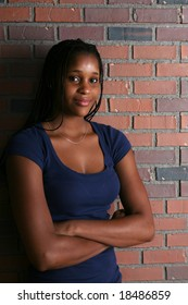 natural light portrait of black teenage girl with arms crossed