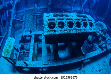 A natural light shot taken from inside a sunken shipwreck. The rusting metal was once a seafaring vessel and is now a sight for scuba divers as well as an artificial reef