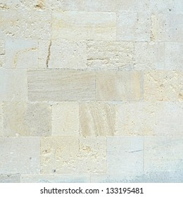 Natural limestone bricks wall texture or background