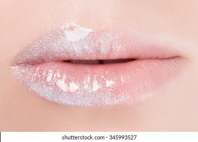Natural lip with white lipstick.