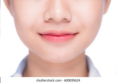 Natural lips. Close up shoot in studio on white