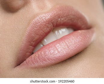 Natural lips. Close up shoot of young beautiful girl with perfect skin: makeup mouth zone. Lips.