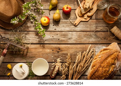 Natural local food products on vintage wooden table - rustic composition captured from above. Country lifestyle, rural vacation or agritourism concept. Background layout with free text space.