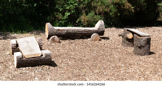 Natural Log home made wood bench rustic in tree trunk in park three