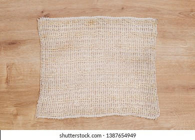 Natural loofah cloth frame, flat lay, copy space. Eco bathroom accessories,  cosmetics products, plastic free. Organic vegan body care and facial care. Sisal Fiber Sponge background