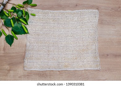 Natural loofah Sisal Fiber frame and birch green leaves, flat lay, copy space. Eco bathroom accessories,  cosmetics products, plastic free. Organic vegan body care and facial care.