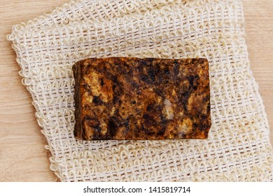 Natural loofah Sisal Fiber Sponge cloth, tar soap Bar , flat lay, top view. Eco bathroom accessories, cosmetics products, plastic free.