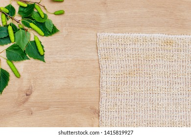 Natural loofah Sisal Fiber Sponge cloth, birch green leaves, flat lay, top view. Eco bathroom accessories, cosmetics products, plastic free. Organic vegan body care and facial care.