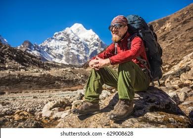 Natural looking backpacker trekking in mountain, Nepal