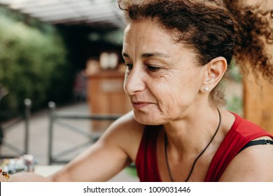 Natural looking portrait of a Latin American middle age woman