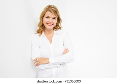 Natural looking woman with hands crossed