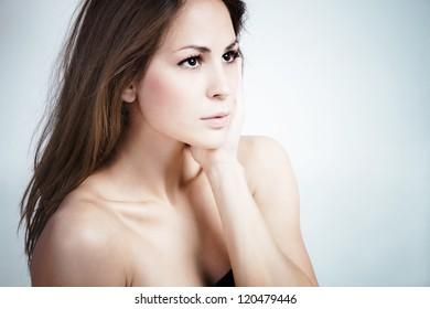 natural looking young woman portrait studio shot