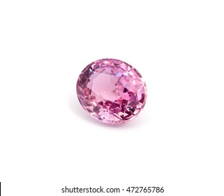 Natural loose pink sapphire gemstone on a white background