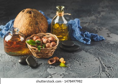 Natural macadamia and coconut oil in a glass bottles with macadamia nuts and cocnut. Use for Healthy Skin and Hair and Natural Healing Oil Treatment