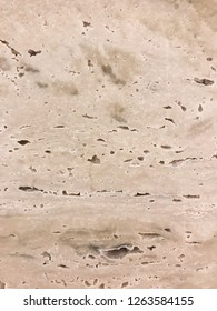 Natural marble wall with holes - Image