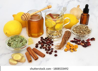 Natural medicinal herbal remedy for cold & flu virus with hot drink with fresh ginger, lemon, honey, cinnamon. echinacea, hawthorn berries, ginseng & eucalyptus essential oil. Immune boosting.