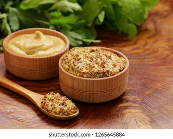Natural mustard, seasoning and sauce on a wooden table
