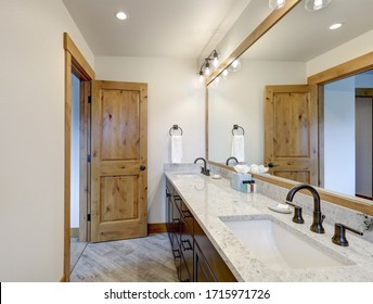Natural new classic bathroom interior with new glass and ceramic tiles walk in tub for shower and grey tiles and dark wood vanity.