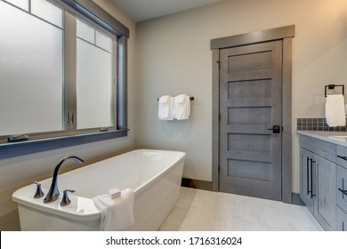 Natural new classic slick bathroom interior with modern and rustic natural design with white tub.