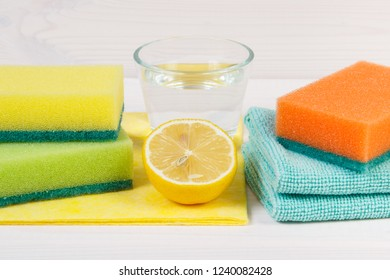 Natural and nontoxic detergents with colorful accessories using at home for cleaning different surfaces, household duties concept