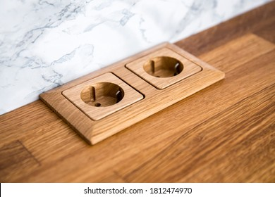 Natural oak wood socket built in natural wood kitchen counter.