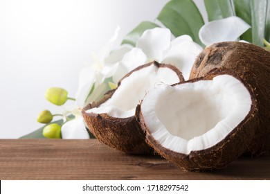natural open coconut fruit with tropical leaves