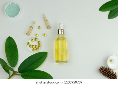 Natural organic cosmetics based on oil or lotion in bottles, sea salt, chamomile cream, liquid capsules. Top view copy space